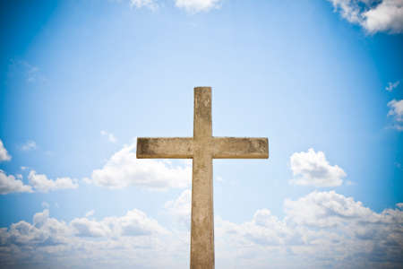 Concrete christian cross against a bright sky - concept image with copy space Stockfoto