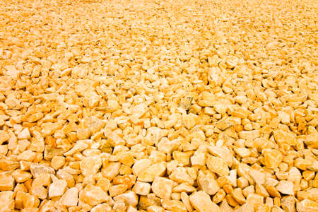 Expanse of orange gravel. Useful image as background - toned image