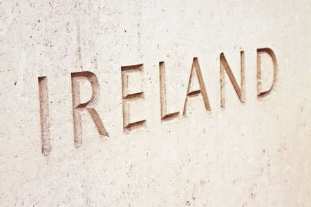 The word Ireland carved on stone wall - image with copy space