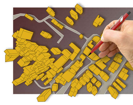 Hand drawing over an imaginary cadastral map of territory with 3D buildings, fields, roads and land parcel of a residential district - image with copy space Reklamní fotografie