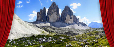 Open theater red curtains against the Tre Cime di Lavaredo panoramic view in summer - Dolomitics landscapes (Italy)view of San Nicolò refuge in Contrin valley (Italy)