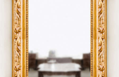 Detail of a carved italian golden wooden frame