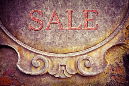 Sale written on stucco wall - concept image - toned image