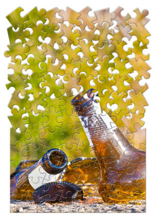 Smashed bottle of beer resting on the ground - Address the alcoholism issue - Concept image in jigsaw puzzle shape