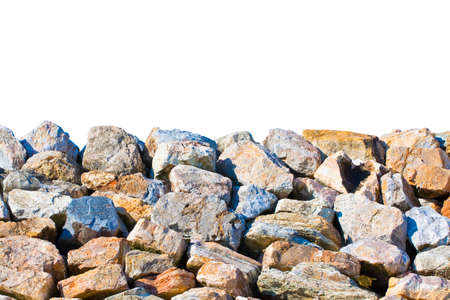 Embankment wall with large stone blocks used along the coasts for protection from sea storms - image on white background with copy space