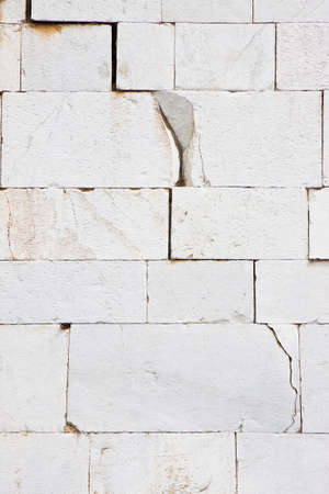 Stone wall deeply cracked - concept image background Reklamní fotografie