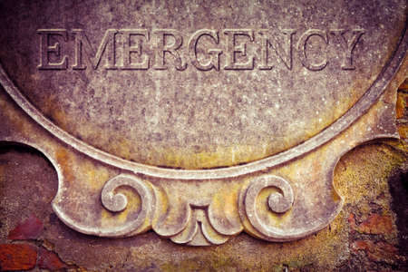 Emergency text written on stucco wall - concept image. Stok Fotoğraf