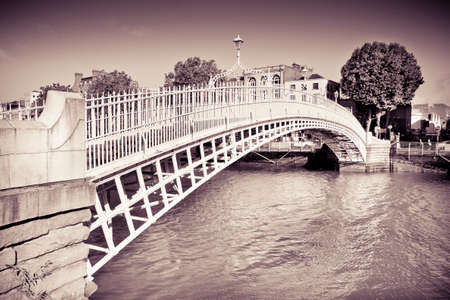 "The most famous bridge in Dublin called ""Half penny bridge"" due to the toll charged for the passage - toned image"