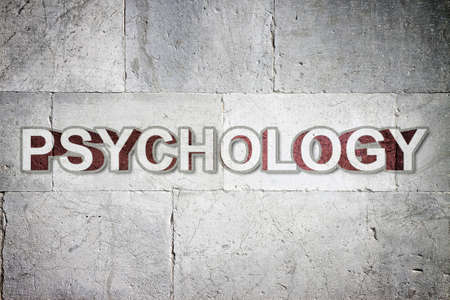 Psychology written on a stone wall - concept image