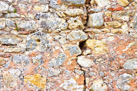 Deep crack in old stone wall - concept image Reklamní fotografie