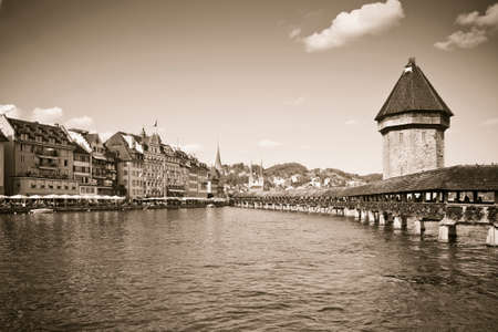 Famous wooden bridge in Lucerne - Switzerland - sepia toned 写真素材