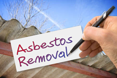 Hand writing Asbestos Removal with a pencil on a sheet - concept image 写真素材