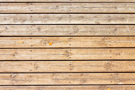 Old wooden floor slats for outdoor use stuck with metal nails 写真素材
