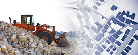 Earth mover with a dam of white stones on a construction site - concept image with a city map. Reklamní fotografie