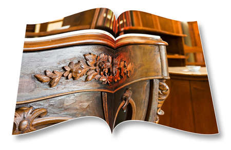 Detail of an antique italian furniture just restored on opened photobook
