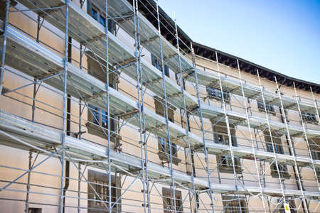 Metal scaffolding for the restoration of a building in a italian construction site