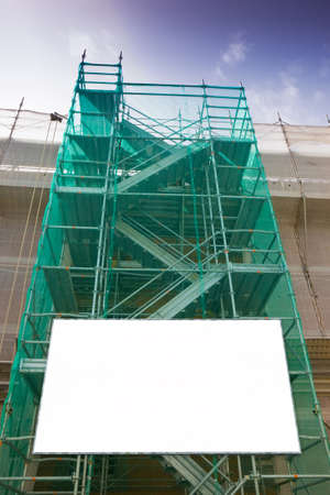 Metal scaffolding, with prefabricated components and blank billboard, to work on the facade for the renovation of the plaster wall Reklamní fotografie