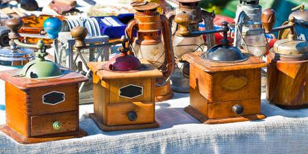 Old italian wooden Coffee grinder exhibited in a street flea market