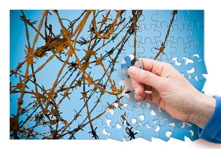 Free yourself from.... Concept image with barbed wire in jigsaw puzzle shape. Jigsaw puzzle means game, but also problem, solutions, strategy, patience, step by step, learning and so on.
