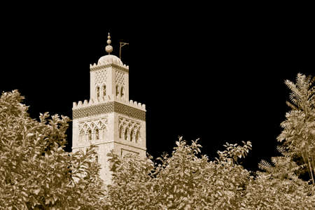 The most important mosque in Marrakech called Kutubiyya or Koutoubia, with the ancient minaret built with bricks according to an elegant and symbolic geometric pattern (Africa - Morocco) - image with copy space