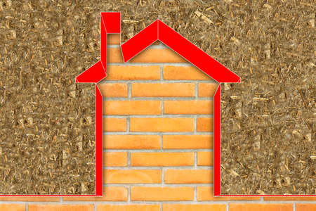 Thermal insulation coatings for residential construction with hemp fiber to reduce thermal losses against an brick wall - Building energy efficiency and environmentally friendly concept image.