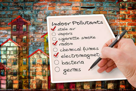 Hand write a check list of indoor air pollutants against a buildings background