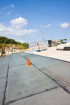 Italian construction site with roof covered with thermal insulation and polystyrene panels with waterproof membrane  스톡 콘텐츠