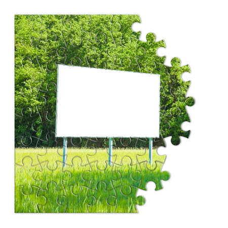 Blank advertising billboard immersed in a rural scene - concept image in jigsaw puzzle shape 스톡 콘텐츠