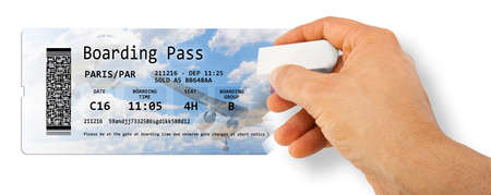 Human hand erases an airline ticket - Flight cancelled concept image - The image is totally invented and does not contain under copyright parts