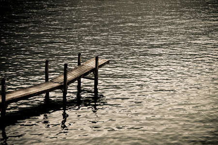 Wooden pier by the lake: silent place concept
