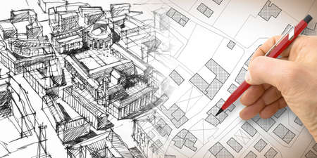 Planning a new city - Engineer-architect drawing with a pencil a sketch of a new modern imaginary town - concept image.
