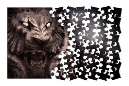 Fear and aggression management - Psychological concept image in jigsaw puzzle shape - Closeup of lion's head with enlightened eyes