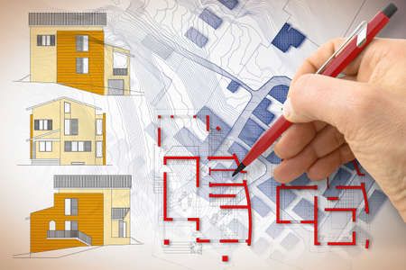 Architect drawing a new residential building over an imaginary cadastral map of territory. Banque d'images