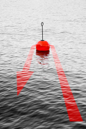 At the turning point - concept image with a red bouy on a calm lake and red arrow that comes back.