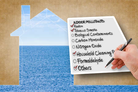 Hand write a check list of indoor air pollutants - concept image against the purity of a natural background.