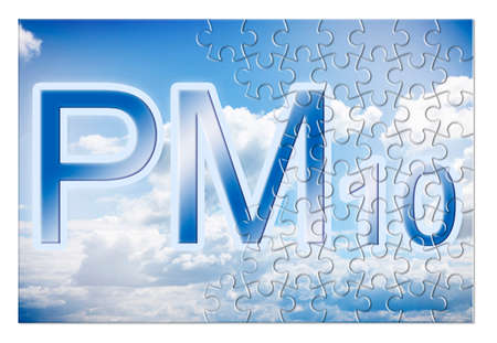 Reduction of particulate matter emission (PM10) in the air - concept image in jigsaw puzzle shape Foto de archivo