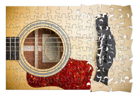 Patience and passion to learn to play the guitar step by step - concept image in jigsaw puzzle shape