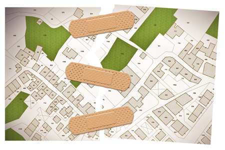 Ripped photo of an imaginary cadastral map of territory with buildings, roads and land parcel - concept image with adhesive bandage.