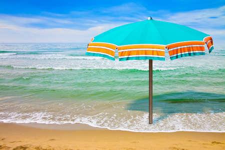Calm sea with beach umbrella - concept image with copy space Reklamní fotografie