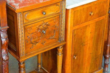 Antique italian wooden bedside table just restored with floral decorations.