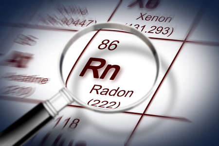 The danger of radon gas - concept image with periodic table of the elements and magnifying lens