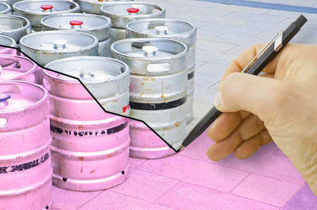 Hand drawing a graph about the trend of beer production with kegs of beer on background