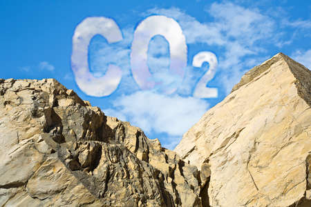 Protection from CO2 carbon dioxide emissions - concept image against a boulders wall on sky background.