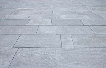 New paving made with stone blocks of rectangular shape in a pedestrian zone.