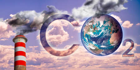 Presence of CO2 in the atmosphere - concept image with a planet Earth image against a cloudy sky and high concrete chimney emits CO2 and dangerous fumes.