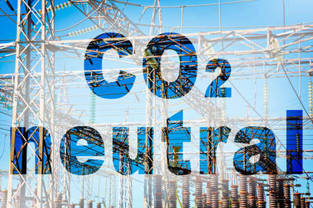 CO2 Neutral text - concept image against a electricity pylon.
