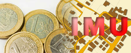 IMU (which means Unique Municipal Tax) the most unpopular italian tax on land and buildings - concept with cadastral map and euro coins.