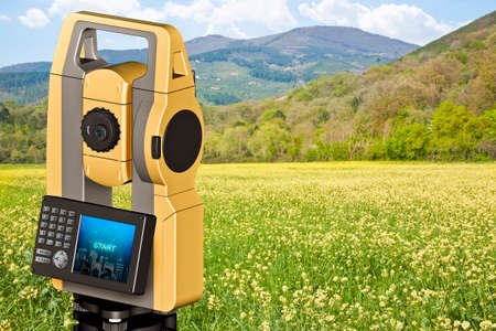 Rural scene with field and 3D rendering of a geodesic device, called Total Station used for the survey of topographic maps and topographical survey. Reklamní fotografie