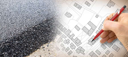 New asphalt paving on urban city roads - concept image with an imaginary city map.