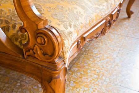 Detail of an antique traditional wooden italian furniture just restored with floral decorations.